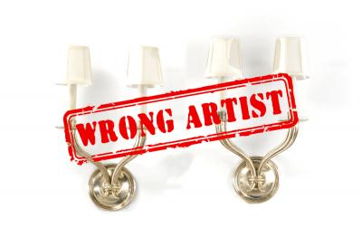 Attribution error for $60,000 sconces to Emile-Jacques RUHLMANN